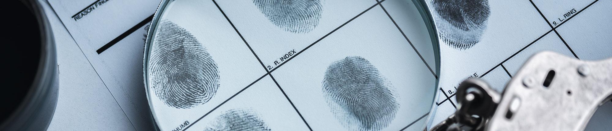 fingerprints under a magnifying glass