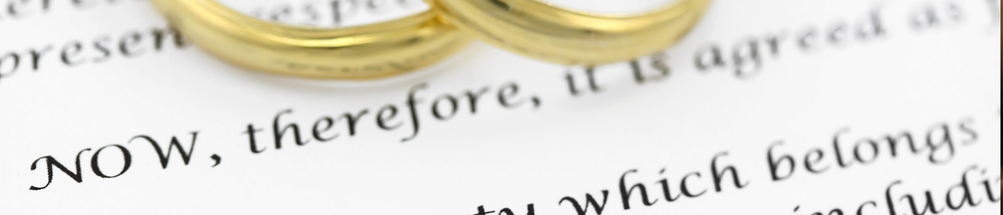 wedding rings over vows on paper