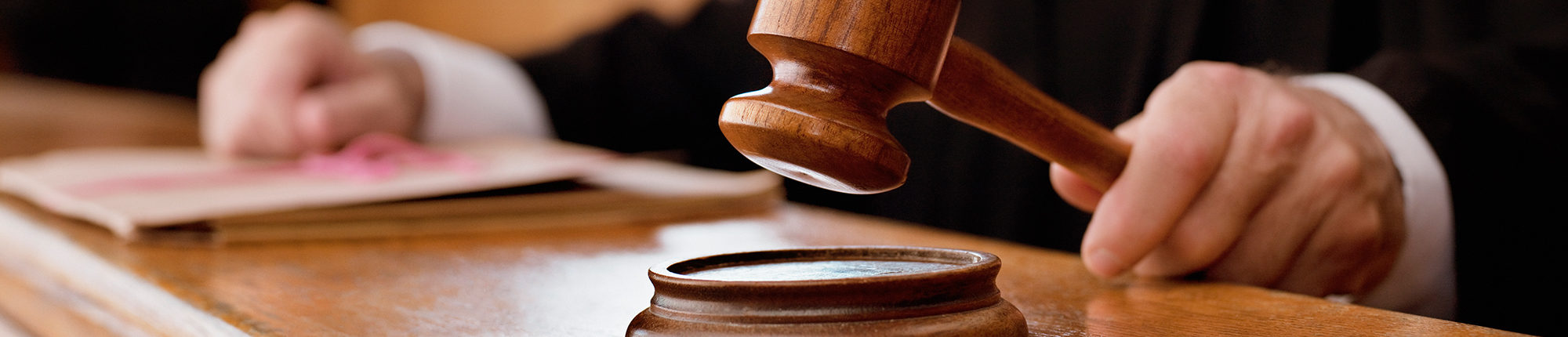 judge holding the gavel in a court room